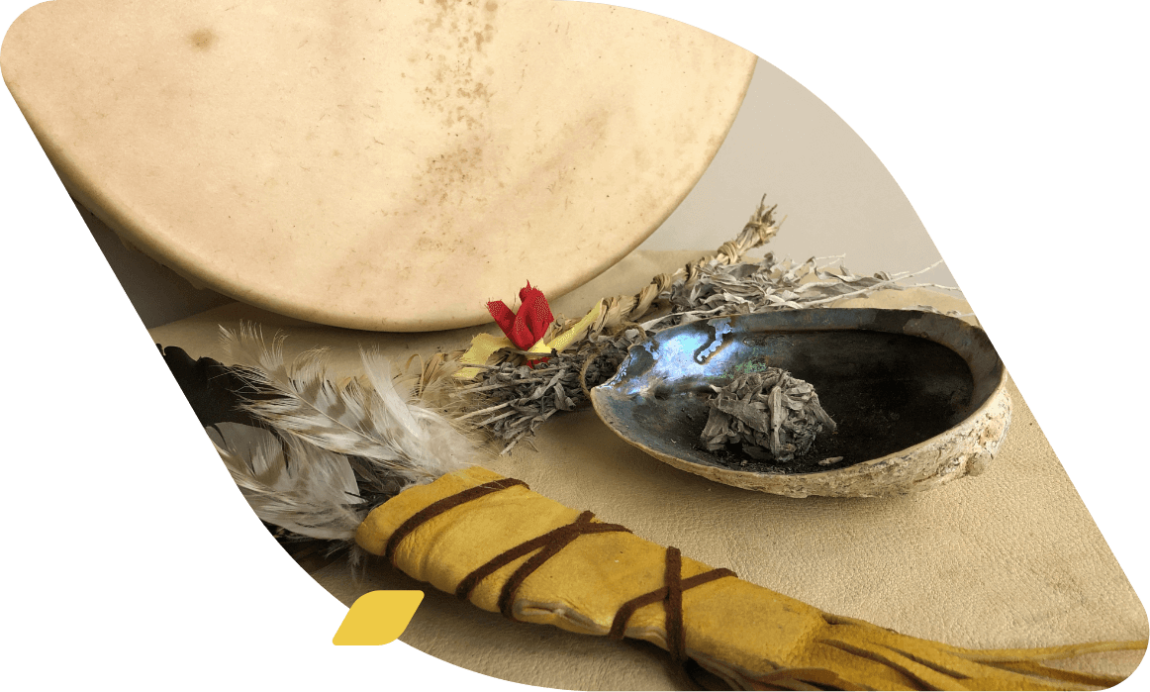 drum, smudge bowl, and feather